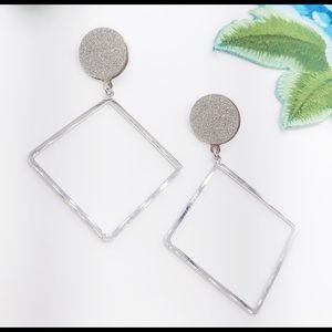 NWT Geometry dangling earrings